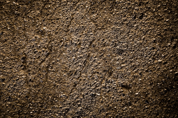 Fond de texture d'asphalte d'or.