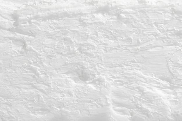 Fond texturé en béton blanc