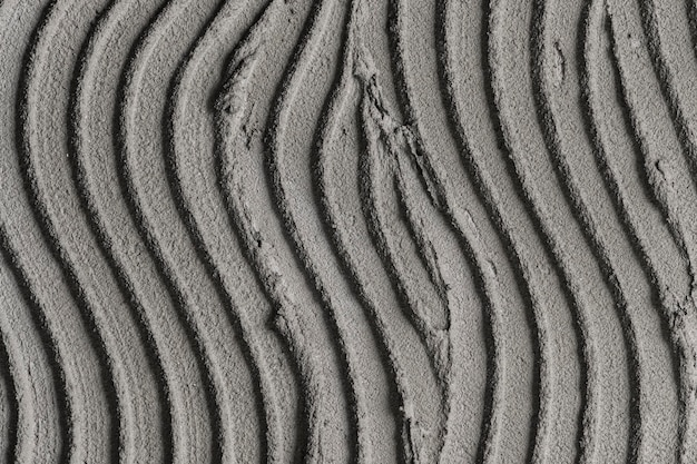 Fond texturé en béton motif vague grise