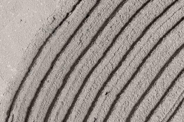 Fond texturé en béton à motifs gris courbe
