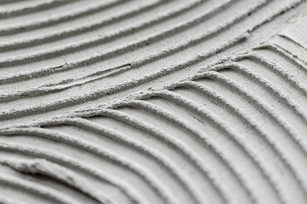 Fond texturé béton à motifs ondulés gris