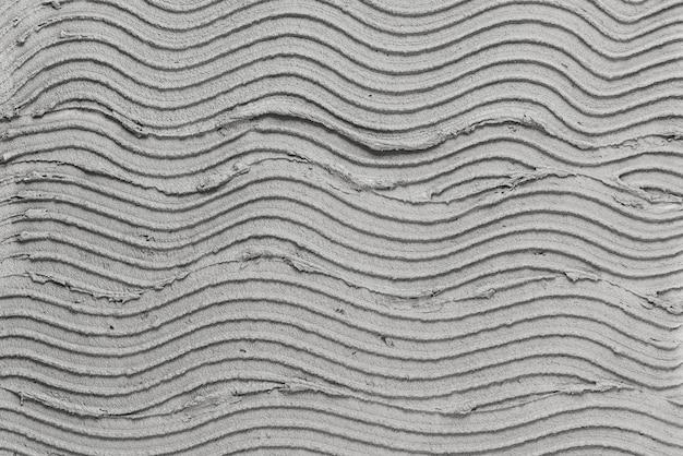 Fond texturé en béton à motifs de vague grise