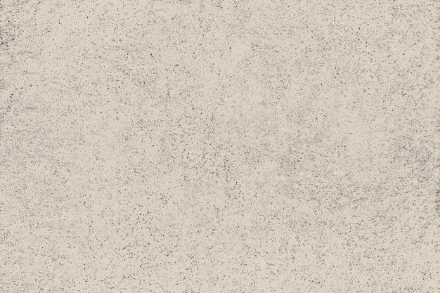 Fond texturé en béton peint beige