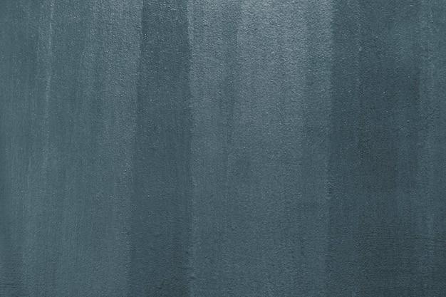 Fond texturé en béton peint en gris