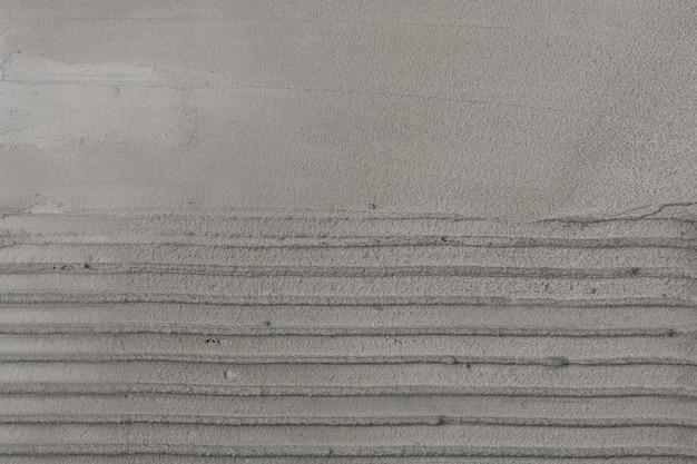 Fond texturé béton rayé gris