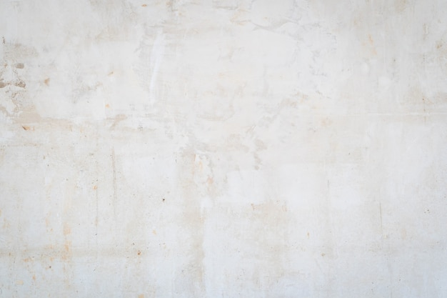 Fond de texture blanche, béton rustique. grunge de mur de béton peint patiné, place pour le texte ou l'image