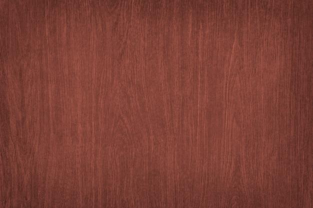 Fond texturé en bois lisse rouge