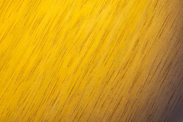 Fond de texture bois peint jaune.