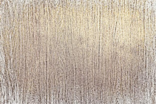 Fond texturé en bois peint en or rustique