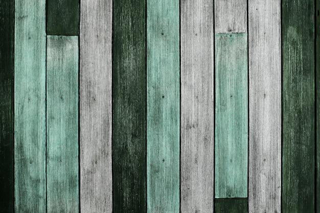 Fond de texture en bois. planche grunge et vieillie. bois vintage patiné. ton vert