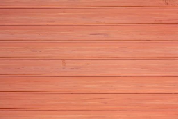 Fond de texture en bois rouge
