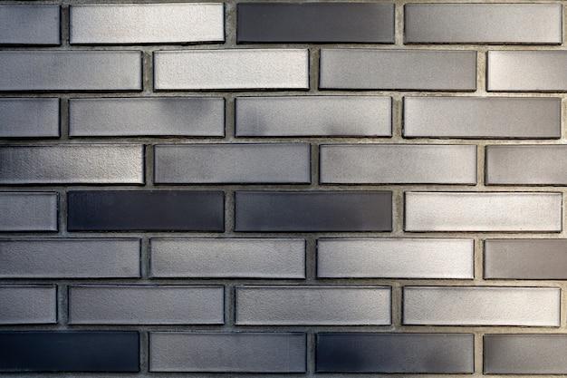 Fond de texture de brique en céramique gris foncé bouchent