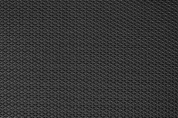 Fond de texture en caoutchouc noir avec motif transparent.