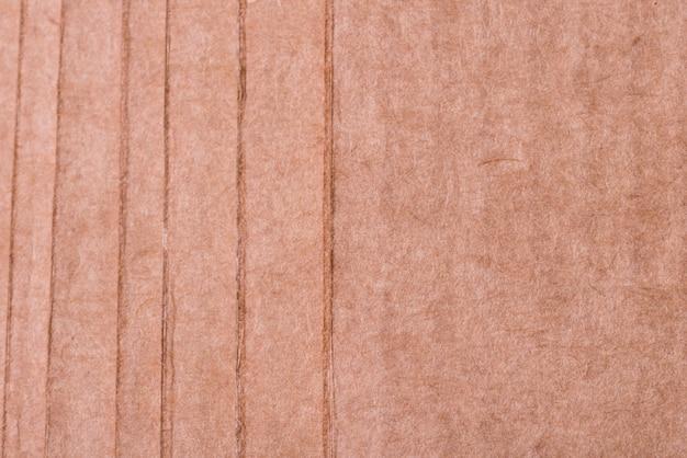Fond texturé en carton brun, gros plan