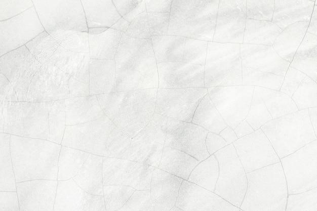 Fond de texture cassée de mur blanc en béton