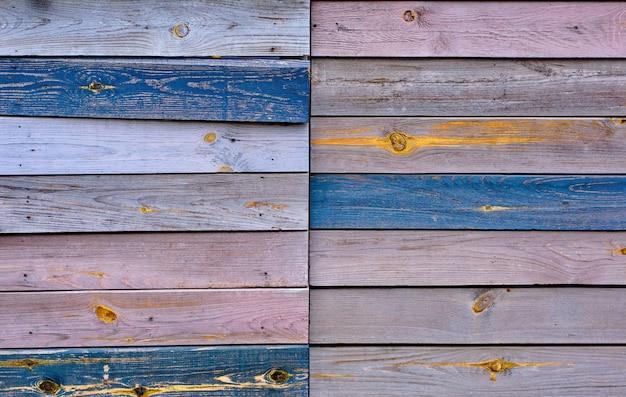 Fond de texture de clôture en bois rustique de couleurs marron et jaunes naturelles