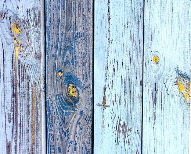 Fond de texture de clôture en bois rustique de couleurs naturelles marron et jaune