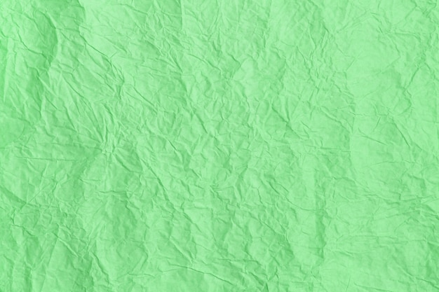 Fond texturé coloré menthe à la mode, texture de papier froissé.