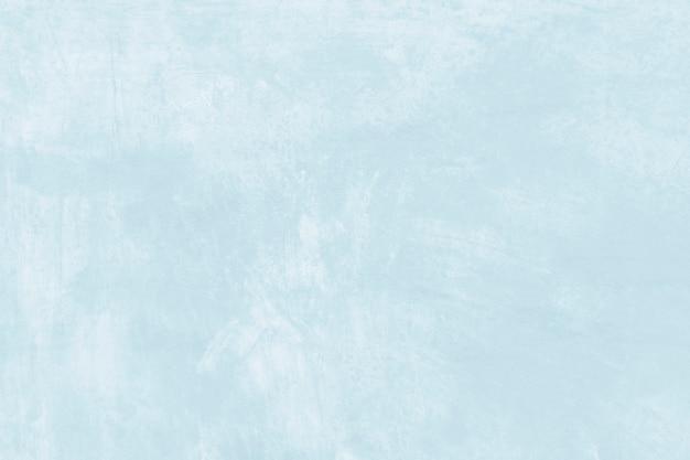 Fond texturé de coup de pinceau de peinture bleu pastel abstrait