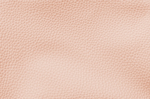Fond texturé en cuir artificiel orange pastel