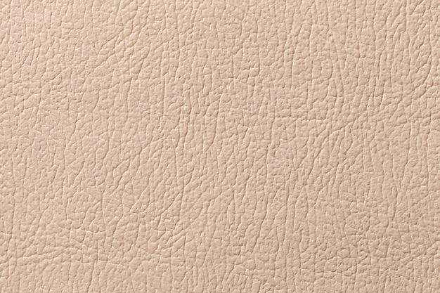 Fond de texture de cuir beige avec motif, gros plan