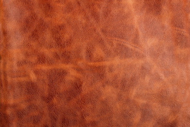 Fond ou texture en cuir brun naturel avec des rayures