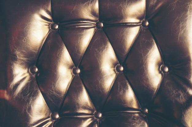 Fond de texture en cuir foncé avec motif boutonné