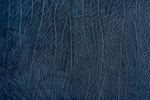 Fond texturé en cuir froissé bleu foncé