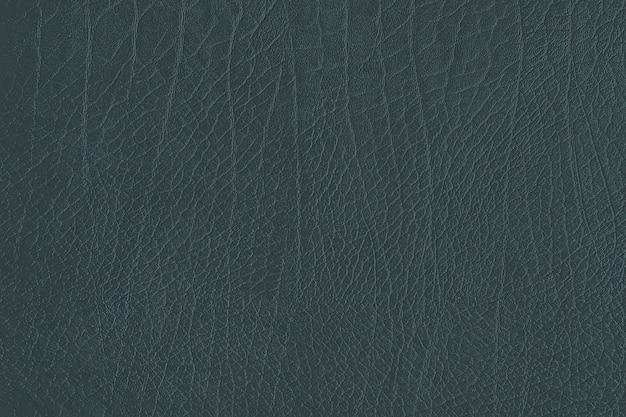 Fond texturé en cuir froissé vert foncé