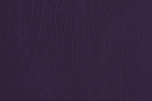 Fond texturé en cuir froissé violet foncé