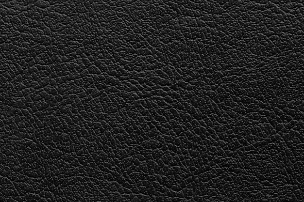 Fond de texture de cuir noir avec motif sans soudure et haute résolution.