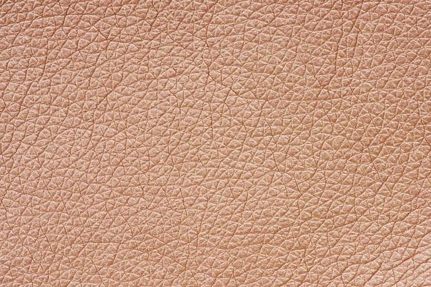 Fond texturé en cuir or rose