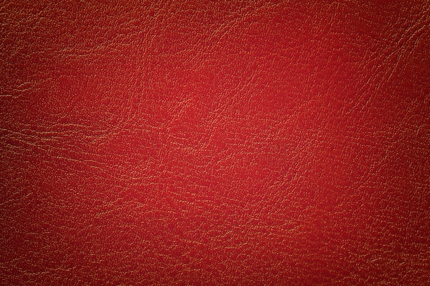 Fond de texture de cuir rouge foncé, gros plan. toile de fond fissurée par la brique de la peau des rides.