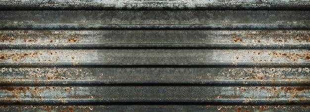 Fond et texture du vieux mur de zinc rouillé.