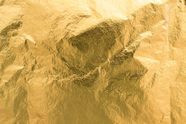 Fond de texture de feuille d'or, élément de décoration de papier d'emballage brillant