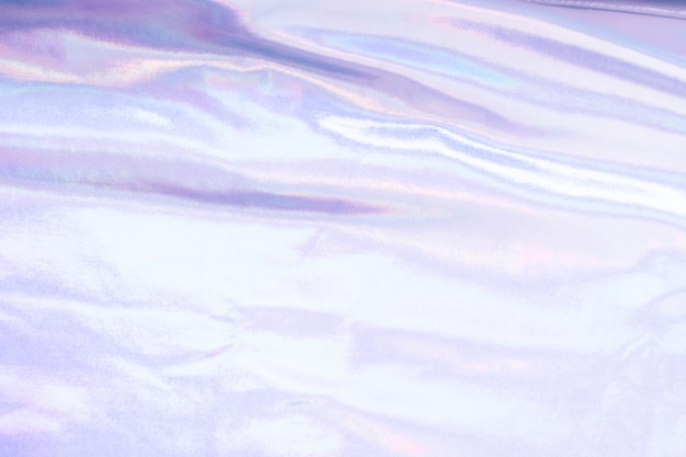 Fond de texture de feuille de sirène irisée holographique. couleurs argentées tendance néon futuristes