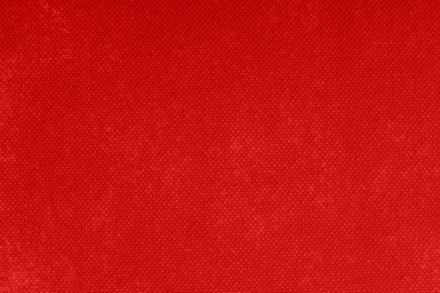 Fond et texture de feutre rouge.