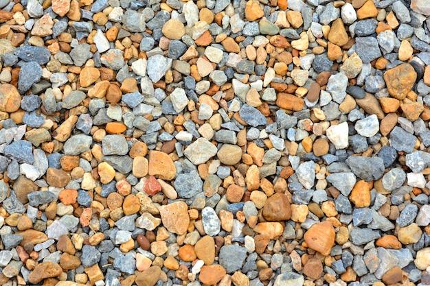 Fond de texture de galets colorés sur le sol