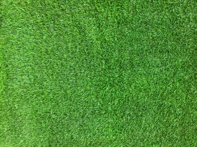 Fond de texture de gazon artificiel vert. photo de bureau sur une pelouse verte.