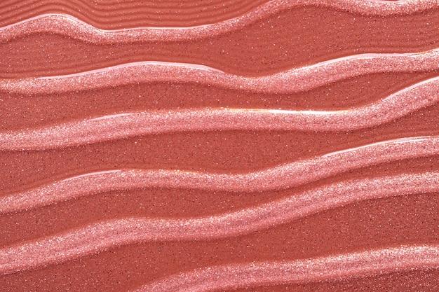 Fond de texture de gel à l'huile marron or scintillant cosmétique