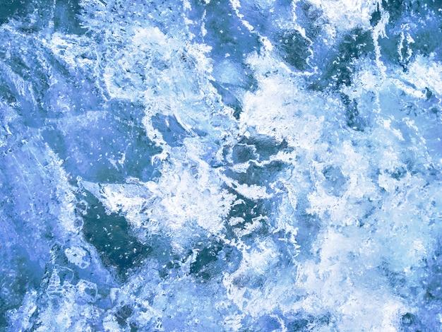 Fond texturé de glace bleue