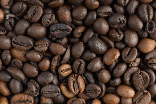 Fond de texture de grains de café. mise à plat, vue de dessus, macro.