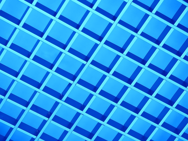 Fond de texture de grille en métal bleu