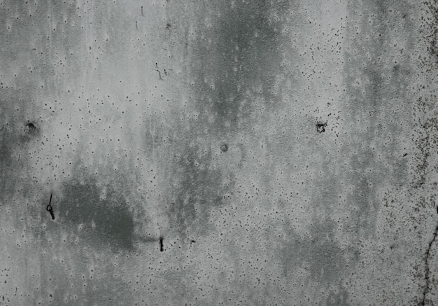 Fond texturé gris béton.