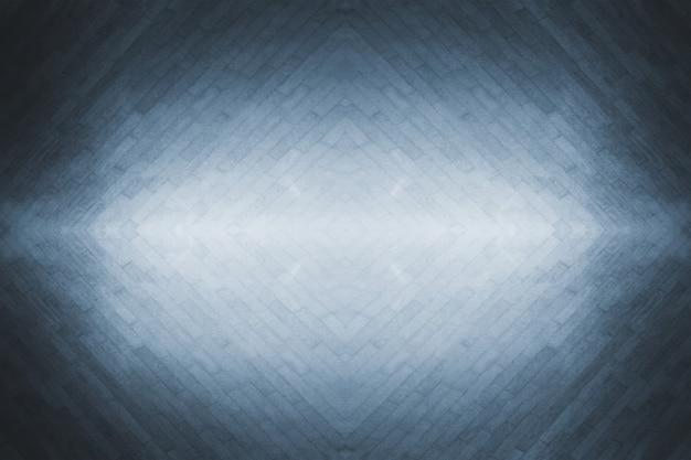 Fond de texture grise avec motif de ligne et sol en béton de chaussée de grille avec lumière