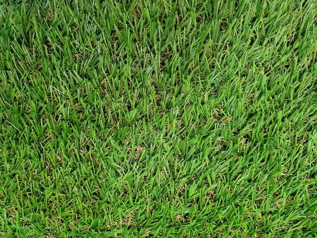 Fond et texture d'herbe verte artificielle