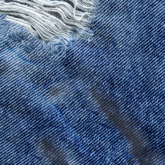 Fond de texture jean denim bleu. jeans texture de tissu déchiré