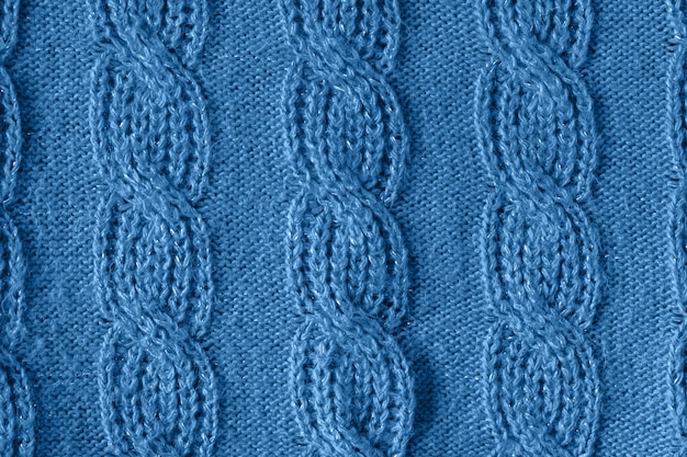 Fond de texture de laine tricotée bleue