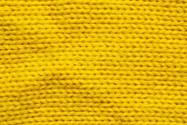 Fond de texture de laine à tricoter jaune