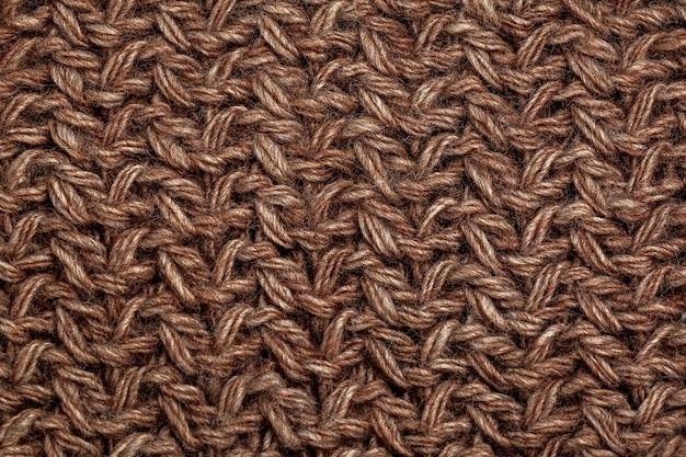 Fond de texture de laine à tricoter marron fait à la main